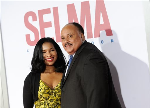 """Martin Luther King III and wife Arndrea Waters attend the premiere of """"Selma"""" at the Ziegfeld Theatre on Sunday, Dec. 14, 2014, in New York. (Photo by Evan Agostini/Invision/AP)"""