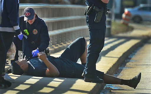 A Charlotte firefighter tends to Carolina Panthers NFL football quarterback Cam Newton following a two-vehicle crash not far from the team's stadium in Charlotte, N.C., Tuesday, Dec. 9, 2014. (AP Photo/The Charlotte Observer, Todd Sumlin)