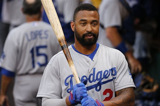 This July 21, 2014, file photo shows Los Angeles Dodgers' Matt Kemp in the dugout before a baseball game against the Pittsburgh Pirates in Pittsburgh. A person with knowledge of the situation says the San Diego Padres have a deal in place to acquire outfielder Matt Kemp and catcher Tim Federowicz from the division rival Los Angeles Dodgers for catcher Yasmani Grandal and two pitchers. The person spoke on condition of anonymity Thursday, Dec. 11, 2014, because the deal hadn't been announced by either team. (AP Photo/Gene J. Puskar, File)