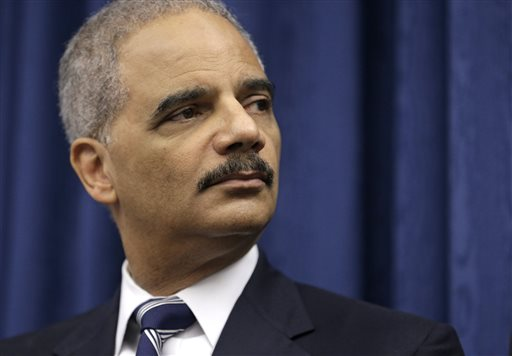 In this Thursday, Dec. 4, 2014, file photo, U. S. Attorney General Eric Holder speaks during a news conference before a roundtable meeting in Cleveland. New racial profiling guidelines are being announced by the Obama administration that would exempt agents from the Homeland Security Department who do border checks and screen passengers at airports. An official said Friday, Dec. 5, 2014, that the new guidelines exempt the Transportation Security Administration in entirety and also do not cover inspections at port of entry and interdictions at border crossings. The official was not authorized to discuss the guidelines by name and spoke on condition of anonymity. Holder had said Monday night that he expected the new guidelines, which apply to federal law enforcement but not local police officers, would be announced in coming days. (AP Photo/Tony Dejak)