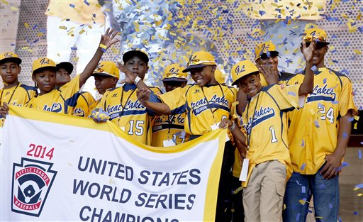 "In this Aug. 27, 2014, file photo, members of the Jackie Robinson West All Stars Little League baseball team participate in a rally celebrating the team's U.S. Little League Championship in Chicago. Little League International said it is confident that Chicago's national championship Little League team did not violate ""residency regulations"" after investigating allegations that the team added top suburban players to make it stronger. The allegations made by Chris Janes of the Evergreen Park Athletic Association were first reported Tuesday, Dec. 16 in DNAinfo.com. (AP Photo/Charles Rex Arbogast, File)"