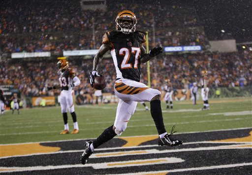 Cincinnati Bengals cornerback Dre Kirkpatrick (27) reacts following an interception during the second half of an NFL football game against the Denver Broncos Monday, Dec. 22, 2014, in Cincinnati. (AP Photo/AJ Mast)