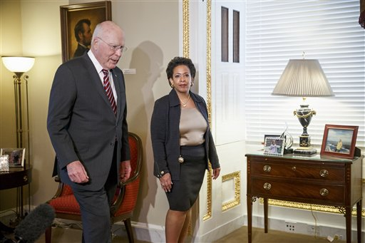 In this Dec. 2, 2014 file photo, Attorney General nominee Loretta Lynch meets with Senate Judiciary Committee Chairman Sen. Patrick Leahy, D-Vt. on Capitol Hill in Washington. As the Justice Department opens a civil rights investigation into the chokehold death of an unarmed man in New York City, the prosecutor in charge of the probe is juggling another high-profile role: designated heir to Eric Holder as the nation's attorney general. The dual positions have placed Loretta Lynch in a public spotlight ahead of Senate confirmation hearings, a period when cabinet nominees normally seek a lower profile to avoid providing fodder for critics. She'll inevitably be questioned about the investigation into Eric Garner's death, an obvious priority for a Justice Department seeking to address concerns about police use of force and racial bias in law enforcement.  (AP Photo/J. Scott Applewhite, File)