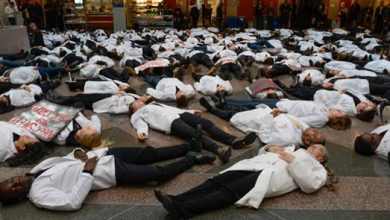 """Photo of Medical Students Hold """"White Coat Die-In"""" Across the U.S."""