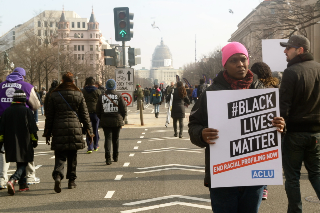 A woman protesting the deaths of Michael Brown and Eric Garner in Washington, DC (Jazelle Hunt/NNPA)
