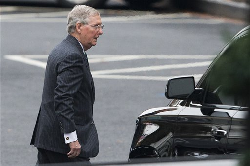 Senate Minority Leader Sen. Mitch McConnell of Ky. leaves the White House in Washington, Wednesday, Dec. 3, 2014, after a meeting with President Barack Obama. Facing a new political landscape, President Barack Obama and McConnell had a Wednesday appointment to size up prospects for cooperation between Democrats and Republicans who have shown little zest for political deal-making in the more than five years since Obama's first inauguration.  (AP Photo/Evan Vucci)