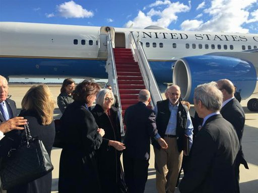This handout photo from the Twitter account of Sen. Jeff Flake, R-Ariz. shows Alan Gross arriving at Andrews Air Force Base, Md., Wednesday, Dec. 17, 2014. The US and Cuba have agreed to re-establish diplomatic relations and open economic and travel ties, marking a historic shift in U.S. policy toward the communist island after a half-century of enmity dating back to the Cold War, American officials said Wednesday. The announcement came amid a series of sudden confidence-building measures between the longtime foes, including the release of American prisoner Alan Gross, as well as a swap for a U.S. intelligence asset held in Cuba and the freeing of three Cubans jailed in the U.S. Gross' wife Judy is at center. (AP Photo/Jeff Flake)