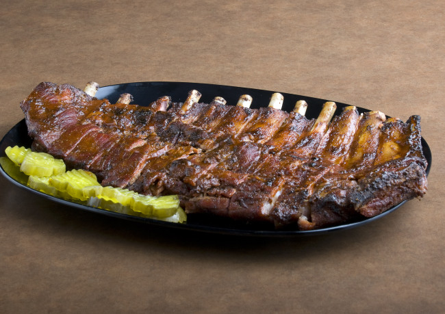 A plate of barbecue ribs is seen at Gates Bar-B-Q in Kansas City, Mo., Friday, May 2, 2008. (AP Photo/Chuck France)