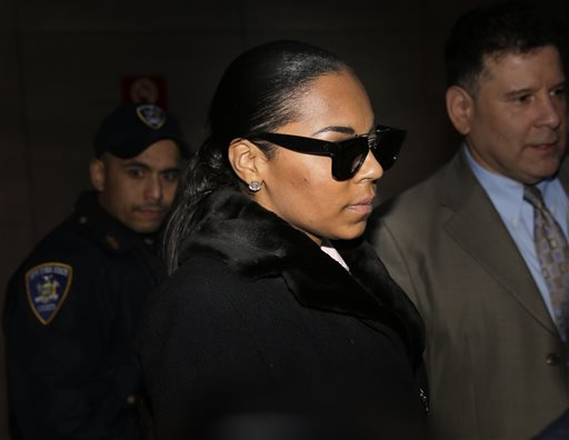 "Singer Ashanti leaves the courthouse after testifying at Devar Hurd's trial in New York, Tuesday, Dec. 16, 2014. Ashanti said in testimony that she was ""disgusted"" and ""absolutely scared"" when she learned in July 2013 that Hurd, who had been convicted of stalking her, had since been tweeting her X-rated messages and posed for a photo with her sister. (AP Photo/Seth Wenig)"