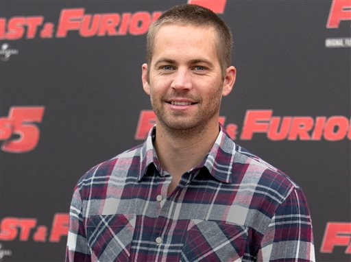 "In this April 29, 2011 file photo, actor Paul Walker poses during the photo call of the movie ""Fast and Furious 5,"" in Rome. A man who stole part of the Porsche that Walker died in has been sentenced to six months in jail. City News Service says 26-year-old Anthony Janow was sentenced Tuesday, Dec. 9, 2014, in Southern California. (Photo/Andrew Medichini, File)"