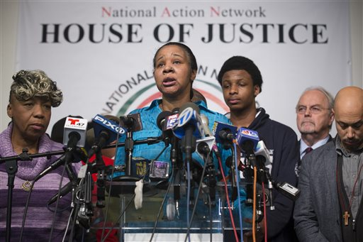 Esaw Garner, wife of Eric Garner, speaks alongside Garner's mother, Gwen Carr, left, during a news conference at the National Action Network headquarters in New York on Wednesday, Dec. 3, 2014 after a grand jury's decision not to indict a New York police officer involved in the death of Eric Garner. A video shot by an onlooker and widely viewed on the Internet showed the 43-year-old Garner telling a group of police officers to leave him alone as they tried to arrest him. The city medical examiner ruled Garner's death a homicide and found that a chokehold contributed to it. (AP Photo/John Minchillo)