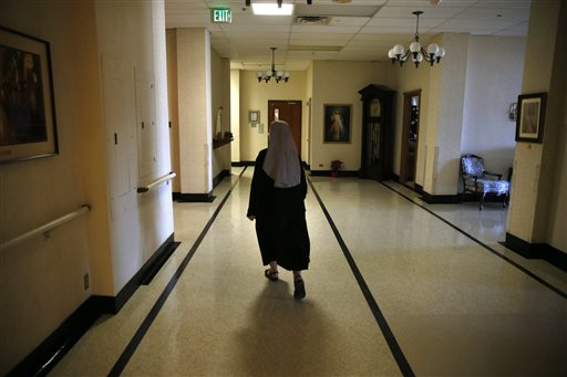 FILE - In this Thursday Jan. 2, 2014, file photo, Mother Patricia Mary walks in the hallway at the Mullen Home for the Aged, run by Little Sisters of the Poor, in Denver. Faith-based nonprofit organizations that object to covering birth control in their employee health plans are in federal court Monday, Dec. 8, 2014, to challenge a birth-control compromise they say still compels them to violate their religious beliefs. The plaintiffs include the group of Denver nuns known as the Little Sisters of the Poor, who run more than two dozen nursing homes for impoverished seniors. (AP Photo/Brennan Linsley, File)