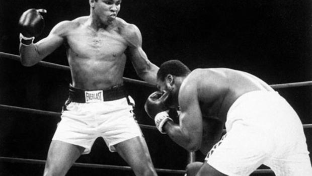 Muhammad Ali, left, throws a punch at Joe Frazier during their Jan. 28, 1974 bout at Madison Square Garden in New York. (AP Photo/File)
