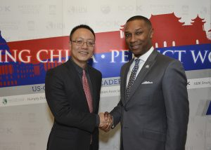 Robert Xiao, the CEO of Perfect World (left) and Johnny Taylor, president and CEO of the Thurgood Marshall College Fund celebrate the new Perfect World U.S.-China Young Leaders Fellowship program. (Freddie Allen/NNPA)