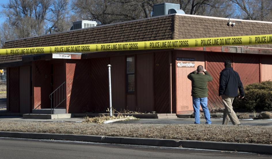 Investigators look over the aftermath of a homemade explosive, which was placed need the Colorado Springs chapter of the NAACP, January 6, 2015. (Christian Murdock/The Colorado Springs Gazette/AP)