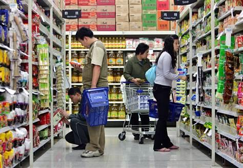 Customers shopping at Wal-Mart in China. (Elizabeth Dalziel/AP Photo)