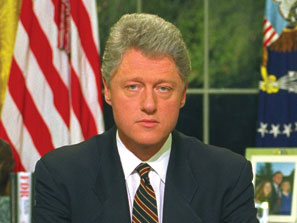 President Clinton sits at his Oval Office desk after making a live televised address to the nation Monday night, October 10, 1994 in the White House. (AP Photo)