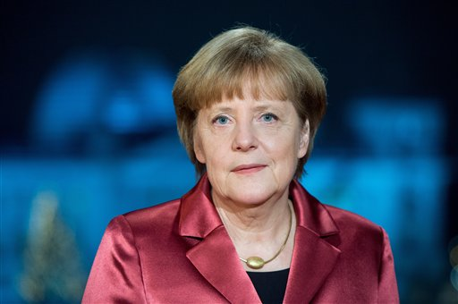 German Chancellor Angela Merkel poses for a photograph after the recording of her New Year's speech at the Chancellery in Berlin, Germany, Tuesday, Dec. 30, 2014. (AP Photo/Maurizio Gambarini, pool)