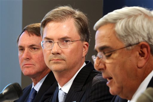 In this Aug. 26, 2010, file photo, then-North Carolina chancellor Holden Thorp, center, listens as then-UNC athletic director Dick Baddour, right, talks during a news conference with then-UNC head coach Butch Davis, left, about possible academic misconduct regaring the college football program in Chapel Hill, N.C. Jon Duncan, the head of NCAA enforcement. says academic misconduct has been on the rise in college athletics and his department is handling 20 open investigations. North Carolina has been the focus of the NCAA's most high-profile infractions case involving academics.  (AP Photo/The News & Observer, Ethan Hyman, File)