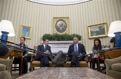 President Barack Obama hosts a bilateral meeting with Mexican President Enrique Pena Nieto, Tuesday, Jan. 6, 2015, in the Oval Office of the White House in Washington. The president is looking to his southern neighbor for help implementing the changing policies on immigration and Cuba. (AP Photo/Carolyn Kaster)