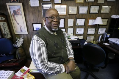 In this Tuesday, Jan. 13, 2015 photo, former state Rep. Wayne Ford sits in his Urban Dreams offices, in Des Moines, Iowa. (AP Photo)