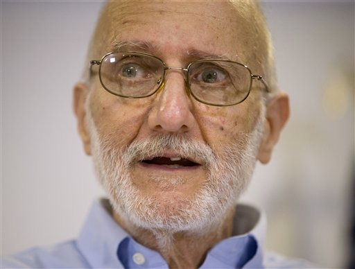 In this Dec. 17, 2014 file photo, Alan Gross speaking during a news conference at his lawyer's office in Washington.  Gross, who returned home last month after spending five years imprisoned in Cuba, will have a prime viewing spot for President Barack Obama's State of the Union address: a seat near first lady Michelle Obama.  (AP Photo/Pablo Martinez Monsivais)
