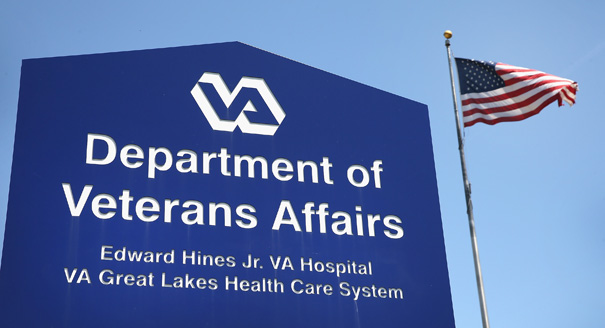 A sign marks the entrance to the Edward Hines Jr. VA Hospital on May 30, 2014 in Hines, Illinois. Hines,  which is located in suburban Chicago, has been linked to allegations that administrators kept secret waiting lists at Veterans Administration hospitals so hospital executives could collect bonuses linked to meeting standards for rapid treatment. Today, as the scandal continued to grow, Veterans Affairs Secretary Eric Shinseki apologized in public and then resigned from his post. (Photo by Scott Olson/Getty Images)