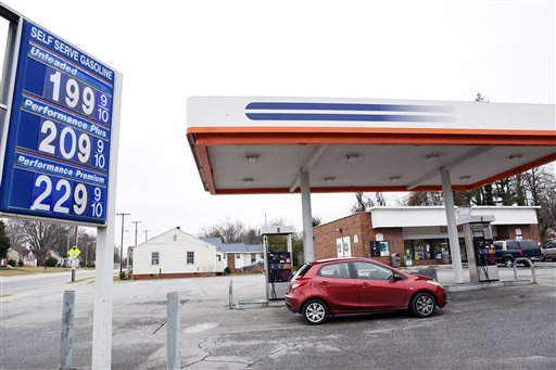 A person gets fuel after gas prices dropped below $2 a gallon at the Quick Mart in High Point, N.C., Wednesday, Jan. 14, 2015. (AP Photo/Daily Free Press, Laura Greene)