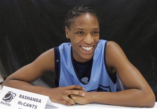 In this March 30, 2008, file photo, North Carolina's Rashanda McCants smiles as she listens to a question during a news conference  in New Orleans. Two former University of North Carolina athletes have filed a lawsuit against the school and the NCAA, saying neither is doing enough to ensure athletes receive a quality education. The lawsuit names McCants and former football player Devo Ramsay as plaintiffs but seeks class-action status. It was filed Thursday, Jan. 22, 2015, in Durham County court. (AP Photo/Donna McWilliam, File)