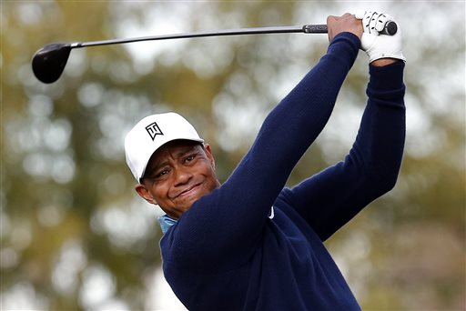 Tiger Woods hits a tee shot on the ninth hole during a practice round for to the Phoenix Open golf tournament on Tuesday, Jan. 27, 2015, in Scottsdale, Ariz. (AP Photo/Rick Scuteri)