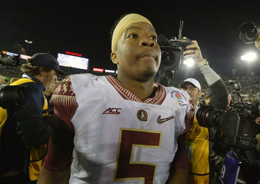 Florida State quarterback Jameis Winston walks off the field after their loss to Oregon during the Rose Bowl NCAA college football playoff semifinal, Thursday, Jan. 1, 2015, in Pasadena, Calif. (AP Photo/Mark J. Terrill)