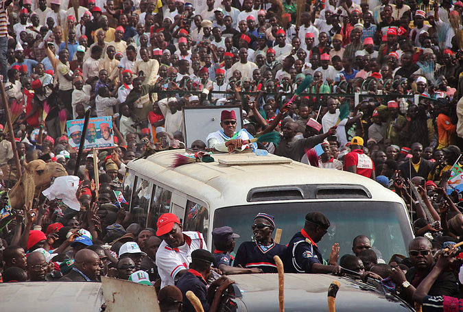 Muhammadu Buhari, center, a 72-year-old former general and Nigerian presidential candidate, at a party rally in Kano. (Sani Maikatanga/Associated Press)