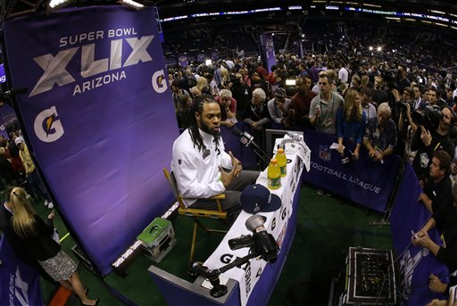 Seattle Seahawks' Richard Sherman answers questions during media day for NFL Super Bowl XLIX football game Tuesday, Jan. 27, 2015, in Phoenix. (AP Photo/Charlie Riedel)