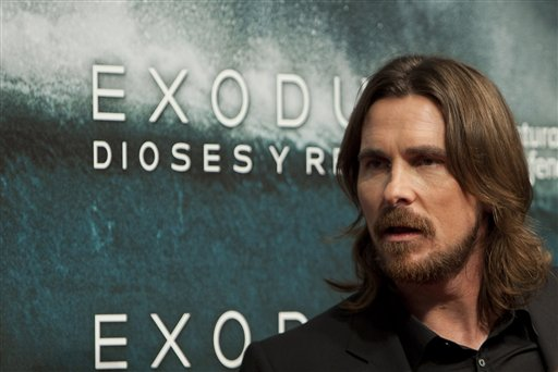 """In this file photo taken Thursday, Dec. 4, 2014, English actor Christian Bale poses for photographers during the premiere of the film """"Exodus"""" in Madrid. Egypt on Sunday, Dec. 28, said it banned Ridley Scott's biblical epic """"Exodus: Gods & Kings"""" because the Hollywood blockbuster distorts Egypt's history and presents a """"racist"""" image of Jews. The Culture Ministry explained its decision for the first time in a statement issued a few days after the ban was announced. (AP Photo/Abraham Caro Marin, File)"""