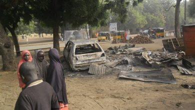 Photo of Nine Days Later, Bodies Still Litter Bushes from Boko Haram's 'Deadliest' Massacre