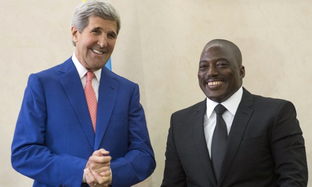 The president of the Democratic Republic of Congo, Joseph Kabila, right, welcomes the US secretary of state, John Kerry, to Kinshasa. (Saul Loeb/AP Photo)