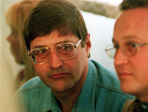 In this Sept. 14, 1998 file photo, Eugene de Kock, the head of a covert police unit that tortured and killed dozens of people, attends an amnesty hearing of the Truth and Reconciliation Commission (TRC) in Pretoria, South Africa. Eugene de Kock, a death squad leader for the apartheid state, has been granted parole after two decades in jail, the South African government announced Friday, Jan. 30, 2015. (AP Photo/Denis Farrell, File)