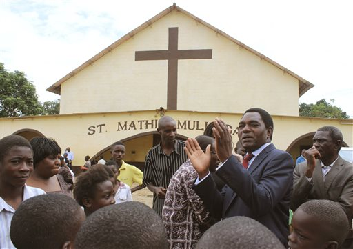 Zambia's leading opposition United Party for National Development (UPND) leader Hakainde Hichilema, second right, addresses supporters after a church service in Lusaka Sunday, Jan. 18, 2015. Zambians go to the polls Tuesday to elect a new president Tuesday after the death of former president Michael Sata in October 2014. (AP Photo/Moses Mwape)