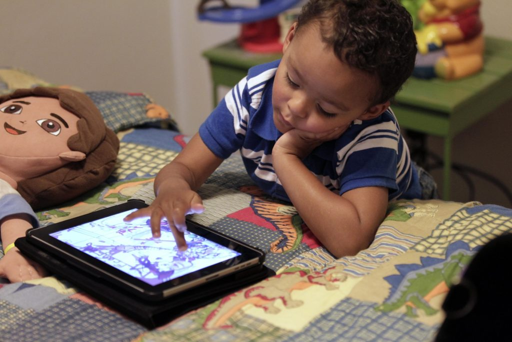 In this Friday, Oct. 21, 2011 photo, Frankie Thevenot, 3, plays with an iPad in his bedroom at his home in Metairie, La. About 40 percent of 2- to 4-year-olds (and 10 percent of kids younger than that) have used a smartphone, tablet or video iPod, according to a new study by the nonprofit group Common Sense Media. (AP Photo/Gerald Herbert)