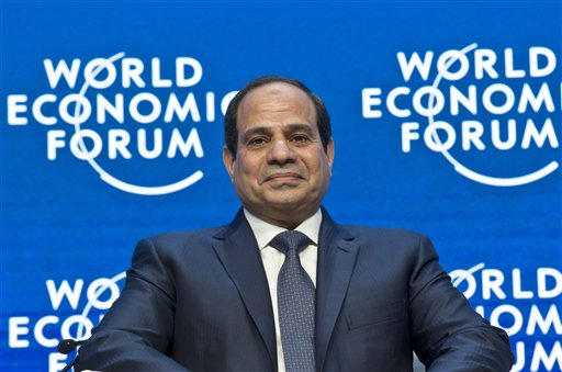 "Egyptian President Abdel-Fattah el-Sissi listens to the opening remarks of the panel ""Egypt in the World"" at the World Economic Forum in Davos, Switzerland, Thursday, Jan. 22, 2015. The meeting runs from Jan. 21 through Jan. 24. (AP Photo/Michel Euler)"