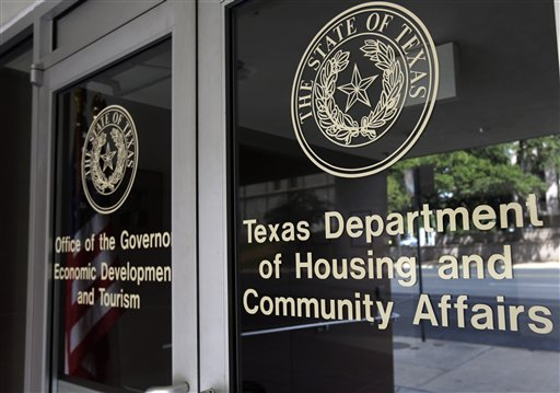 This Aug. 30, 2014, photo shows the Texas Department of Housing and Community Affairs in Austin, Texas.  The Obama administration may need the vote of a frequent conservative antagonist on the Supreme Court to preserve a decades-old strategy for fighting housing discrimination. Justice Antonin Scalia on Wednesday, Jan. 21, 2015, appeared at times to side with the administration and civil rights groups during arguments over the reach of the landmark Fair Housing Act of 1968, a case that otherwise seemed to split the court along ideological lines. Scalia seemed to agree with the court's four liberal justices that the law can be used to ban housing or lending practices without any proof of intent to discriminate. The court is considering a challenge from Texas officials to the use of so-called disparate impact lawsuits, which allege that even race-neutral lending or housing policies can have a harmful effect on minority groups. (AP Photo/Eric Gay, File)