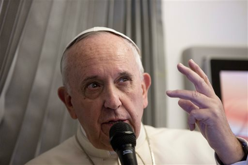 Pope Francis talks with reporters during his flight from Sri Lanka to Manila, Philippines Thursday, Jan. 15, 2015. (AP Photo/Alessandra Tarantino, Pool)