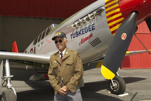 "This April 7, 2011 photo by Bruce Talamon shows Clarence E. ""Buddy"" Huntley Jr., a member of the Tuskegee Airmen, the famed all-black squadron that flew in World War II, posing with a P-51C Mustang fighter plane similar to the one that he was a crew chief on while overseas during the war, at Torrance, Calif., Airport. Huntley and fellow Tuskegee Airman Joseph Shambrey, lifelong friends who enlisted together, both died on the same day, Monday, Jan. 5, 2015, in their Los Angeles homes, relatives said Sunday, Jan. 11, 2015. Both were 91. Huntley and Shambrey enlisted in 1942 and were shipped overseas to Italy in 1944 with the 100th Fighter Squadron of the Army Air Force's 332nd Fighter Group. As mechanics, they kept the combat planes flying. (AP Photo/Bruce Talamon (c) 2011 All Rights Reserved)"