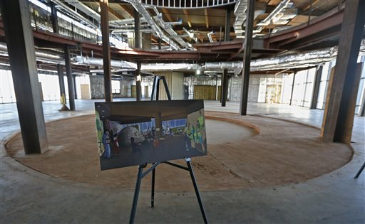 A picture of what the interior of the  unfinished American Indian Cultural Center and Museum will look like one day is on display inside the Museum in Oklahoma City, Tuesday, March 4, 2014. After nearly 10 years and $90 million spent, the state's attempt to build the tourism centerpiece – a Smithsonian-quality museum of native American culture -- has turned into a curious spectacle on full display before hundreds of thousands of motorists who drive by it every day.  (AP Photo/Sue Ogrocki, File)