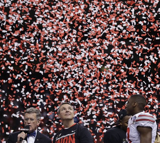Ohio State head coach Urban Meyer, center right, stands on the stage after the Sugar Bowl NCAA college football playoff semifinal game against Alabama, Friday, Jan. 2, 2015, in New Orleans. Ohio State won 42-35.  (AP Photo/Brynn Anderson)
