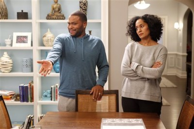 "In this image released by ABS, Anthony Anderson, left, and Tracee Ellis Ross appear in a scene from ""Black-ish."" The series was created by Kenya Barris, who was motivated to write the comedy about an African-American family's efforts to honor its heritage in part by the unreality of what he grew up watching on television. (AP Photo/ABC, Kelsey McNeal)"
