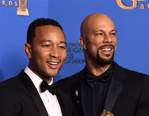 """In this Jan. 11, 2015 file photo, performers John Legend, left, and Common pose in the press room after the award for best original song """"Glory"""" in a film for """"Selma"""" at the 72nd annual Golden Globe Awards in Beverly Hills, Calif. The pair will perform their Oscar-nominated song """"Glory"""" at the Academy Awards. (Photo by Jordan Strauss/Invision/AP, File)"""