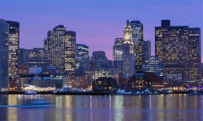 In this Jan. 6, 2012 file photo, the Boston city skyline is illuminated at dusk as it reflects off the waters of Boston Harbor. The U.S. Olympic Committee picked Boston on Thursday, Jan. 8, 2015, as its bid city for the 2024 Summer Games. The city will be presented to the International Olympic Committee for a vote in 2017. Rome also is in the bidding, along with Hamburg or Berlin, Germany. France and Hungary also are considering bids. (AP Photo/Michael Dwyer, File)