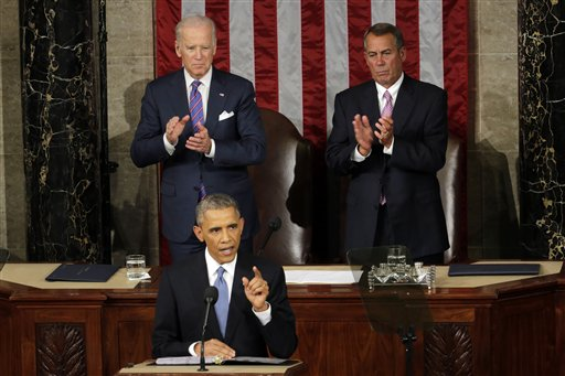 Vice President Joe Biden and House Speaker John Boehner of Ohio applaud President Barack Obama, on  Capitol Hill in Washington, Tuesday, Jan. 20, 2015, during his State of the Union address before a joint session of Congress. (AP Photo/J. Scott Applewhite)