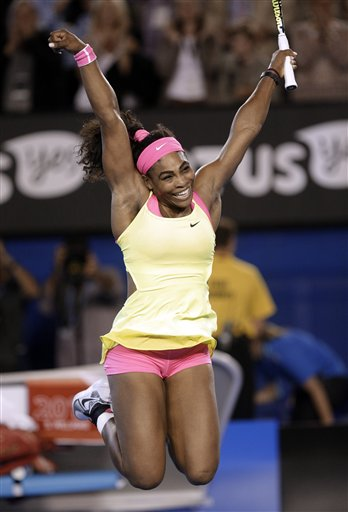 Serena Williams of the U.S. celebrates after defeating Maria Sharapova of Russia in the women's singles final at the Australian Open tennis championship in Melbourne, Australia, Saturday, Jan. 31, 2015. (AP Photo/Bernat Armangue)